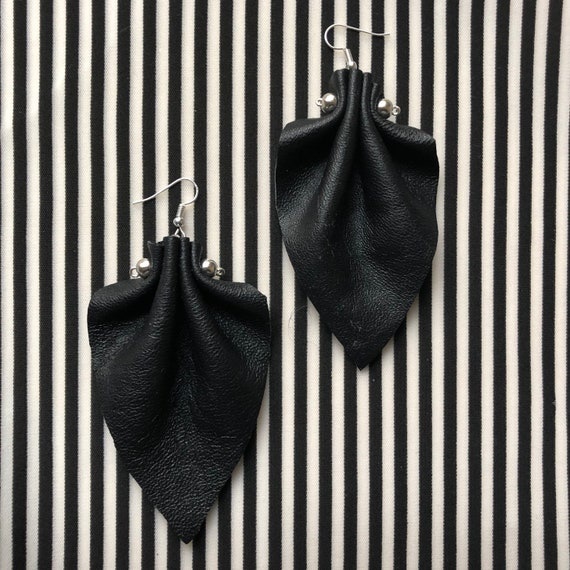Leather sculpted earrings.