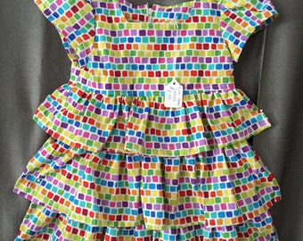 Girl's size 12 mo. dress with ruffles. Multi color print.