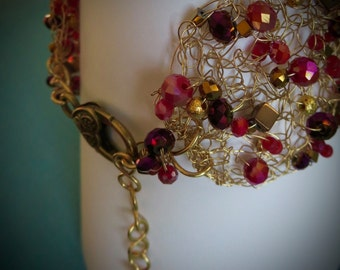 RISE. Reds And Golds. Beaded Crocheted Gold Tone Wire Bracelet