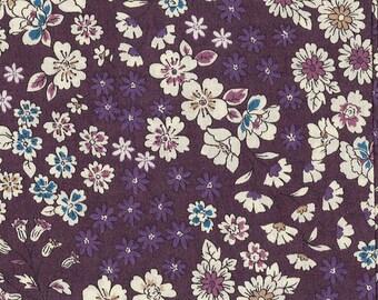 Ruffled purple floral fabric