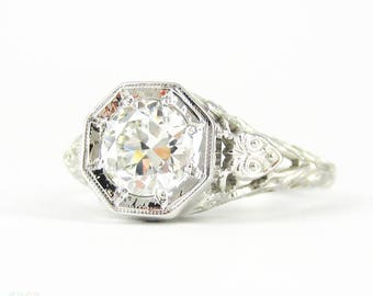 Filigree Diamond Engagement Ring, 0.77 ctw Old Cut Diamond in Floral Style Filigree Stamped 18k White Gold Setting by Jabel, Circa 1920s.