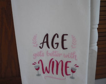 Wine themed  flour sack towel. Machine embroidered.