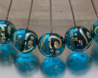 Lampwork headpins - Helix rounds in transparent aqua and silver. Lampwork by Jennie Yip