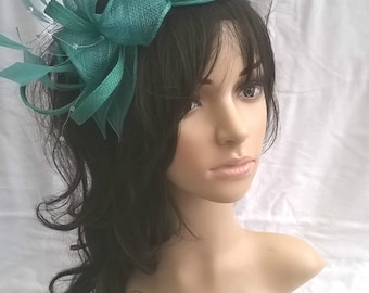 Jade green Sinamay and Feather Rosette Fascinator with Leaves,loops, Feathers and crystal stamens
