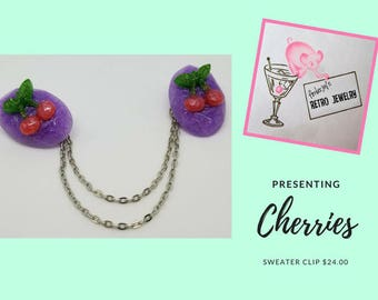 Atomic Cherries on Oval's Sweater Clip