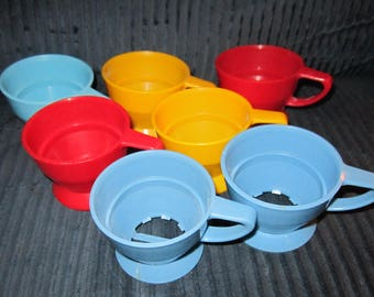 Set of 7 vintage colorful plastic Solo cozy cup holders and cups