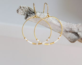 Hoop earrings, gold plated beads and white