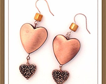Handmade MWL copper heart filigree earrings. 0075