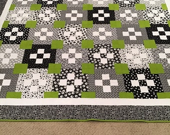 Modern black, white, and green quilt