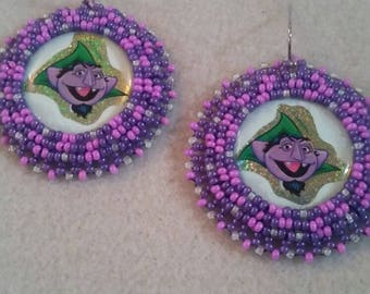 The Count drop cluster earrings