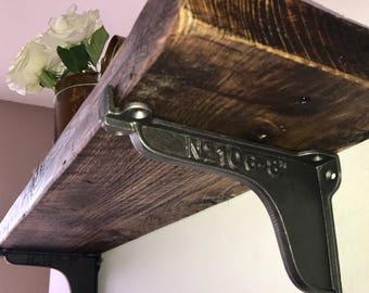 Reclaimed wood shelf and cast iron brackets
