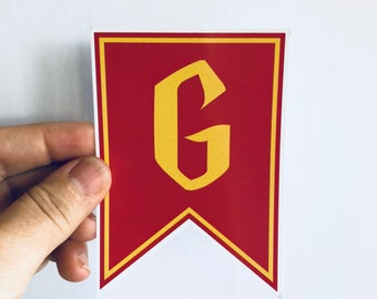 maroon and gold house pennant sticker bumper sticker   laptop sticker   skateboard sticker