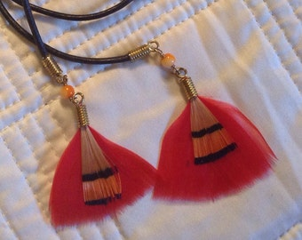 Red feather lariat on black waxed cord