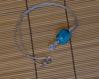 Scarab Swirl, dolomite and sterling silver necklace