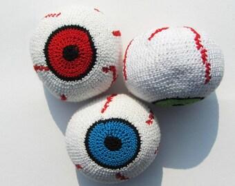 With eye pattern juggling balls.