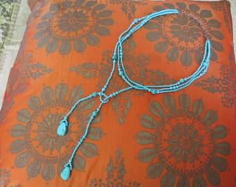 Wonderful turquoise faux lariat necklace.  Very funky and boho chic yet stylish.