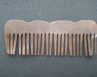 Ancient bronze comb