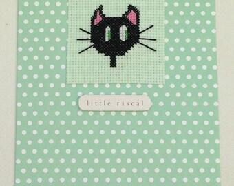 Cat original cross stitch card handmade with the wording 'little rascal'