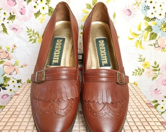 Vintage brown leather tassel loafers size 6.5