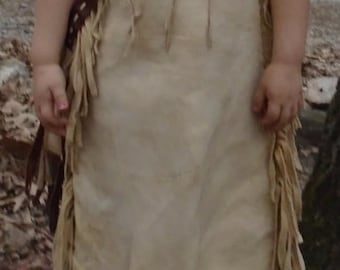 """Braintanned girls primitive fringed dress measuring 27"""" long and 10"""" across the shoulder...ready for your beadwork!"""