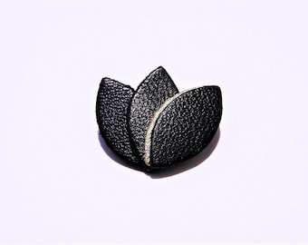 Gold edging and black leather petals brooch