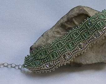 Green and silver Czech glass and Japanese seed beads woven bracelet