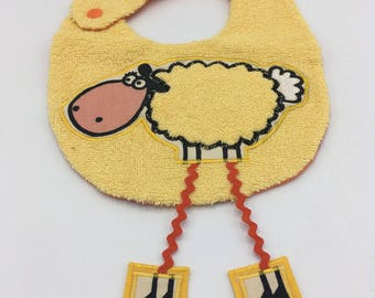 Lamb bib long yellow legs