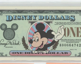 5 Disney Dollars, 5 different ones through the years all getting Very Rare. No longer made, Uncirculated, Mint Condition.  1560a