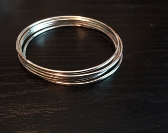 Set of 5 thin, stacking sterling silver bangles