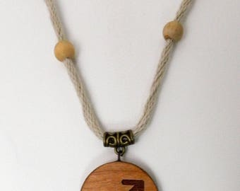 Wooden pendant laser engraved with the signs of the zodiac. (Sagitarius)