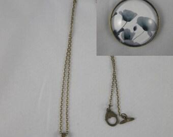 Col027 - Collier / sautoir bronze et cabochon coquelicots en noir et blanc