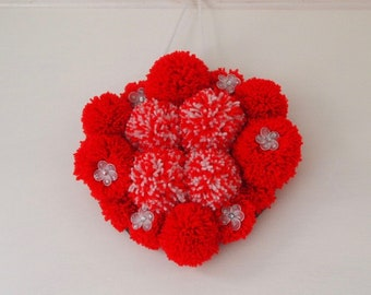 Red and white pompom wall decoration