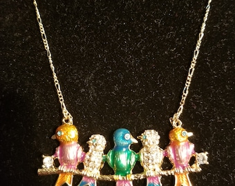 Necklace. Birds on a branch. Gold. 16 inch figaro chain, lobster clasp.