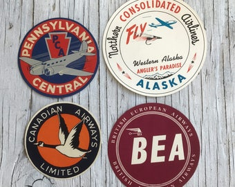Four airline luggage labels. Wonderful collection of original vintage luggage labels. Airline ephemera. Collectable labels. 1950s.