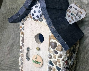 Hobbit style stone birdhouse. Easy clean out door and hanger included. Handmade in Michigan. Durable and affordable!
