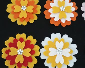 Flowers -   Yellow assortment. pack of 4 with a little sparkle.