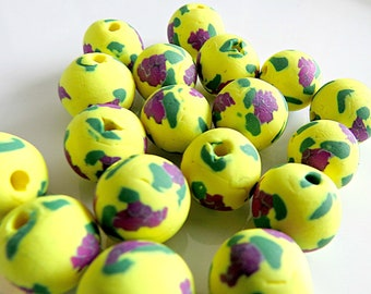 Deep purple lilac with yellow polymer clay bead
