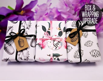 Gift Wrap Upgrade For Gift Giving  - Beautifully gift wrapped box with a bow and a tag.
