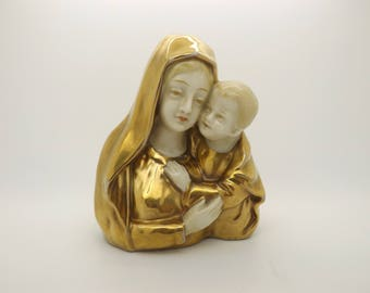 A beautiful Heubach vintage German art pottery figure of the Madonna and child with fully glazed and gilded decoration