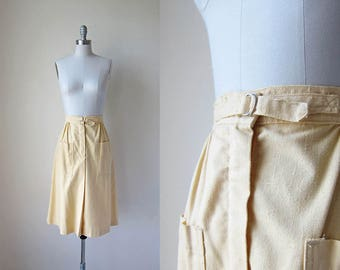 1970s vintage pale yellow deep pocket d ring belted waist midi skirt m