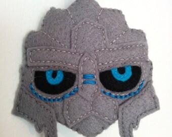 Garrus Vakarian from the Mass Effect games. A felt face, hand sewn in 2-D