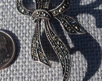 Vintage marcasite ribbon/bow brooch sterling silver frame. circa 1960's.