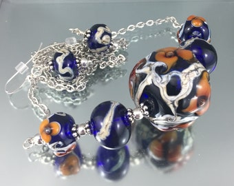 lampworking bead necklace set, amber blue glass, floral beads,  silvered ivory handmade beads, lampwork bead necklace, Murano effetre glass