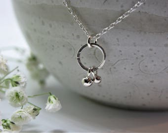Dainty silver necklace with silver droplet pendant