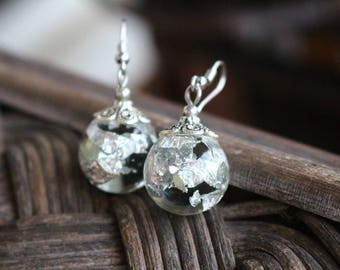 Earrings with silver leaf in resin ball