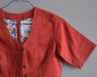 Quilted khadi blouse , hand-spun and handwoven sari blouse , comfort fit , two layered and quilted , front button opening .