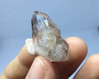 Double terminated Quartz Crystal w/mobile Enhydro (128) 6.1 g