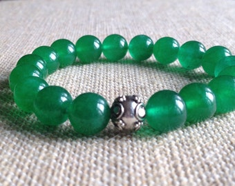10mm Green Jade stretch bracelet with a Sterling Silver Bali Bead