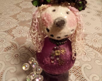 mixed media assemblage purple snow lady with glass body