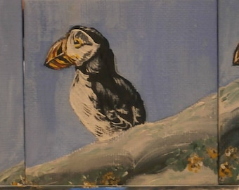 An original acrylic triptych painting of puffins on a rock